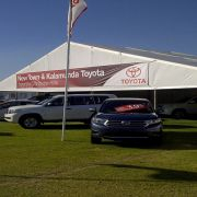 25m_x_10m_Toyota_with_Banner_on_Gable_and_Flagpoles.jpg